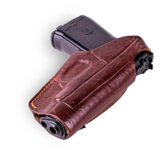 Пистолет в кобуре на белом фоне