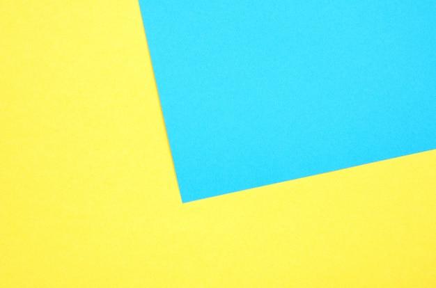 幾何学的な紙の背景。黄色と青緑色の紙テクスチャ背景。