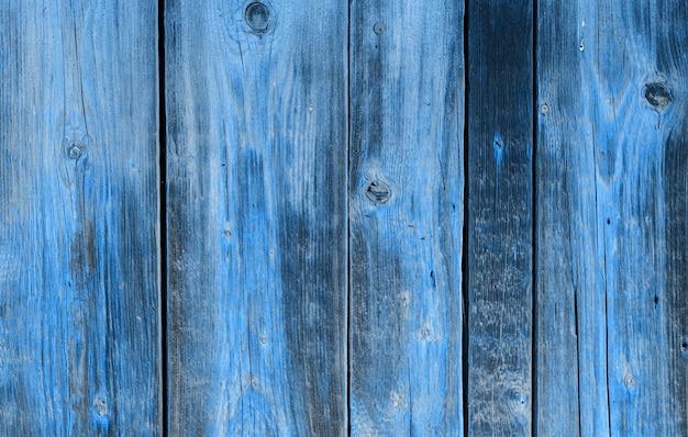 木製の壁。自然のパターンウッドブルーの背景。