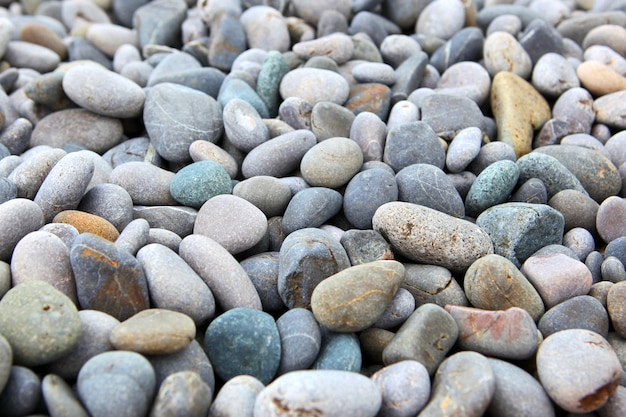 乾燥した丸い小石石と抽象的な背景
