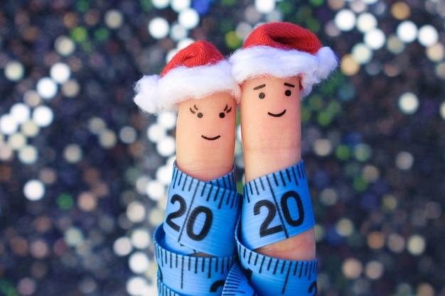カップルの指アートはクリスマスを祝います