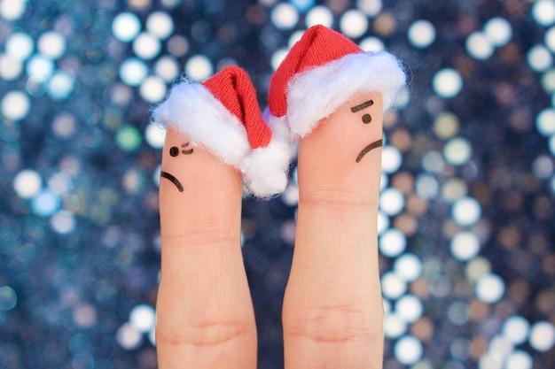 カップルの指アートはクリスマスを祝います。新年のけんか中に男と女の概念。