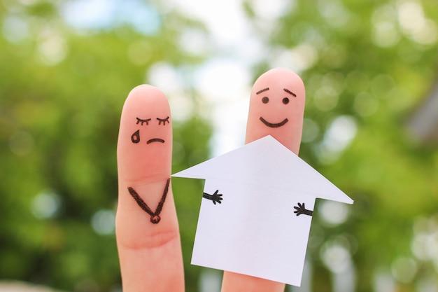 喧嘩中の家族の指アート。男性と女性の概念は、離婚後の家を分割します。