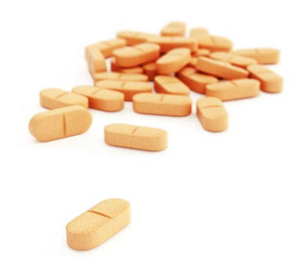 白地にオレンジ色の丸薬