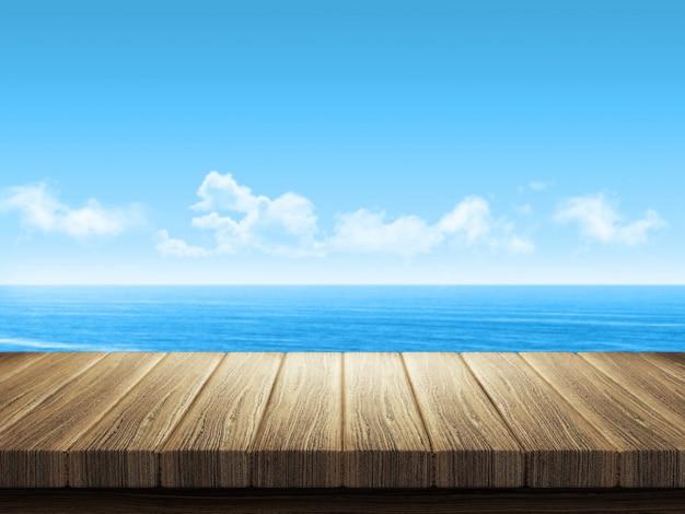背景で海の風景と木製のテーブル