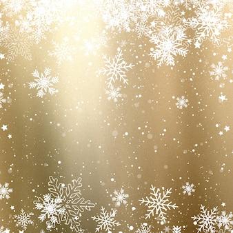 ゴールデンクリスマスの背景と雪片