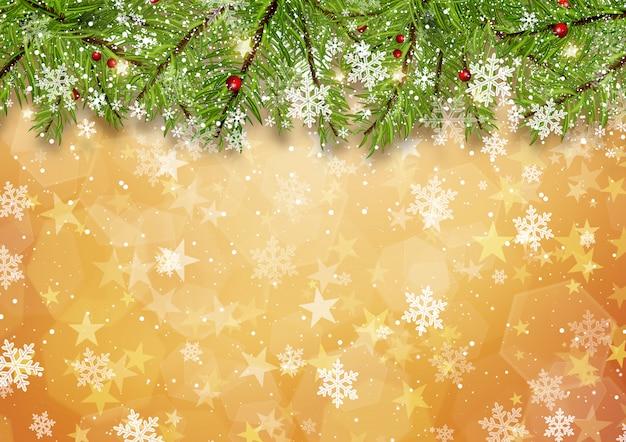 ゴールドスターの背景にクリスマスツリーの枝
