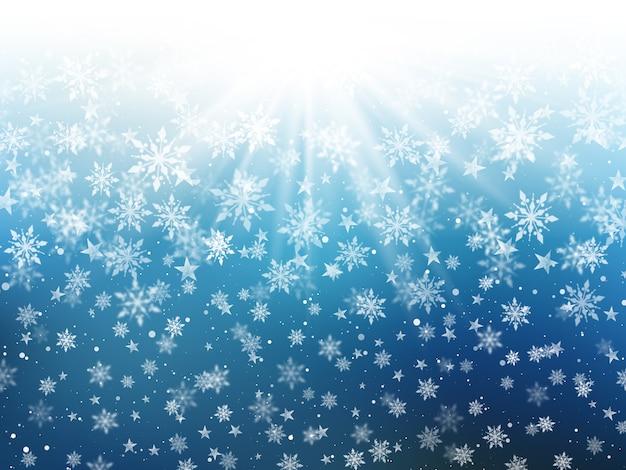落ちる雪片のクリスマスの背景
