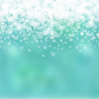 クリスマスの背景と雪片のデザイン