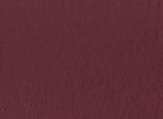 Текстура бордовой ткани в катушках