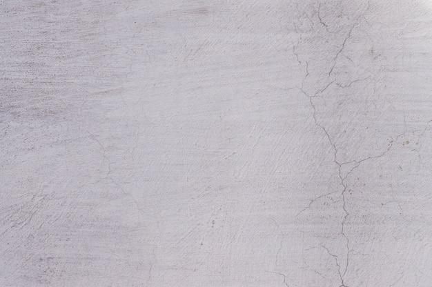 白塗りの古いぼろぼろの壁のテクスチャ