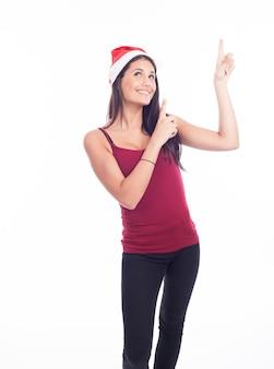 指している幸せなクリスマス女