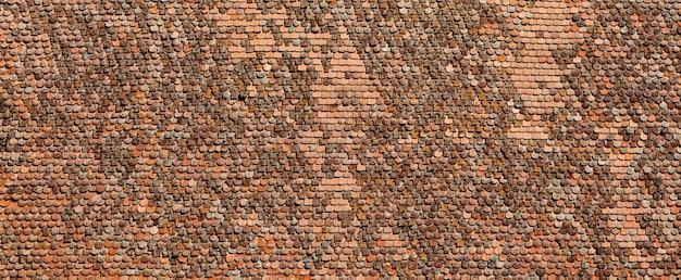 古い粘土のタイルの背景