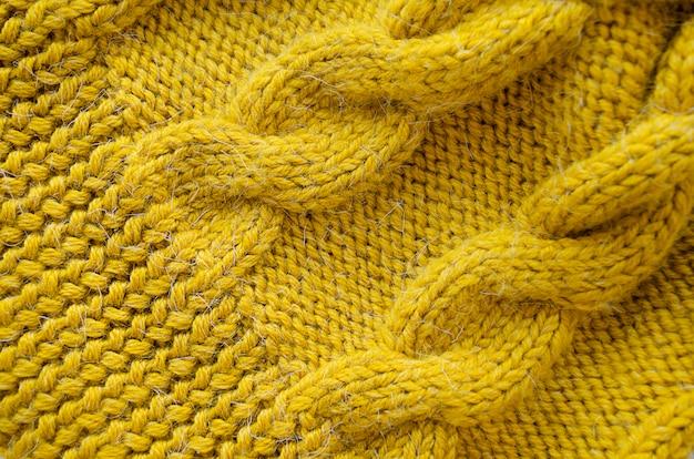 ニットの背景ニットの質感。ウールの編み物模様。