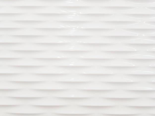 白い滑らかでなめらかな壁の抽象的な背景