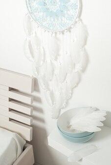 Голубой снов с белыми перьями