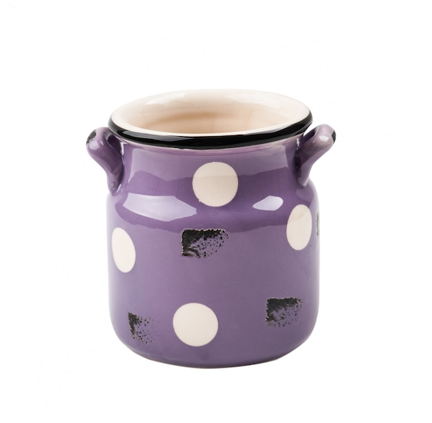 紫の素朴な古いエナメルマグカップ
