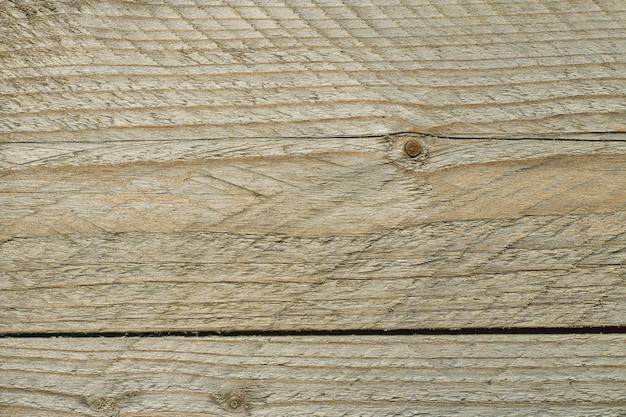 茶色の傷の木製ボード。古い木材のテクスチャ、トップビューの表面