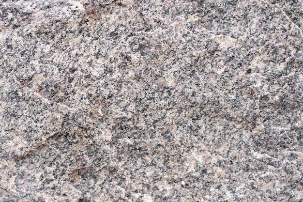 Пористый камень гранит фоновой текстуры