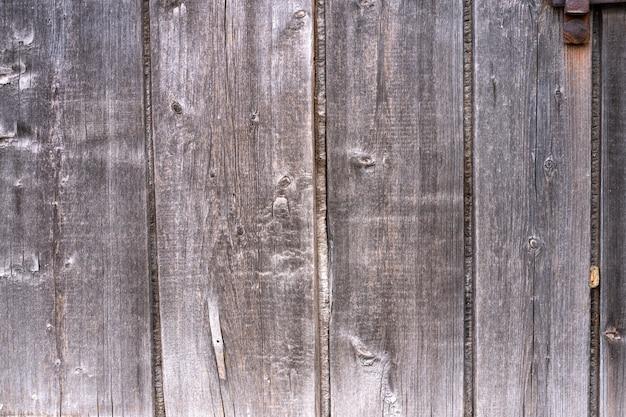 Доски текстуры старой деревянной загородки тухлые. задний план