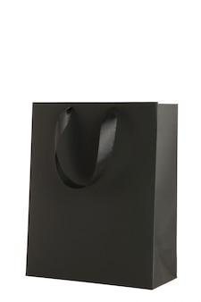 白で隔離される黒いショッピングバッグ。