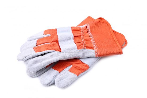 白で隔離される建設手袋