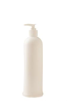 白い壁に分離された化粧品ボトル。上面図