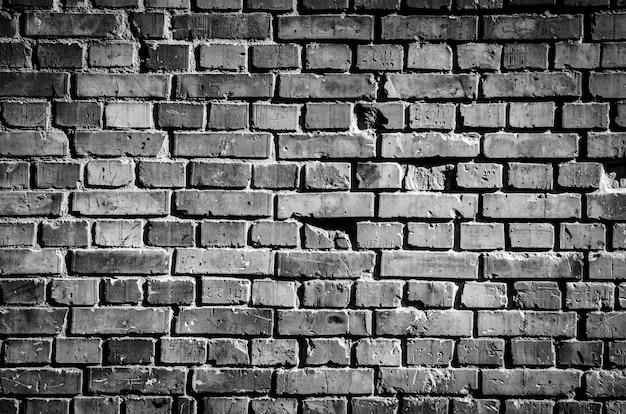 黒レンガの壁の背景テクスチャ
