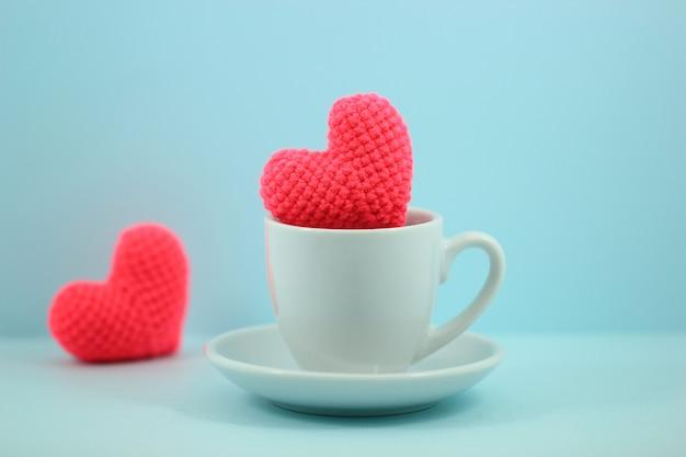 二つの心を持つカップ
