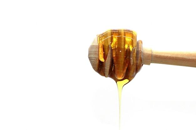 白い背景の写真撮影に分離された蜂蜜