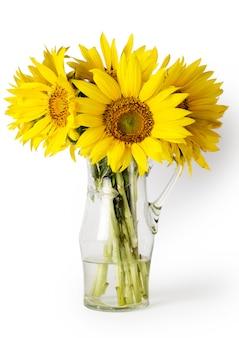 白で隔離される花瓶に明るい黄色の花束。