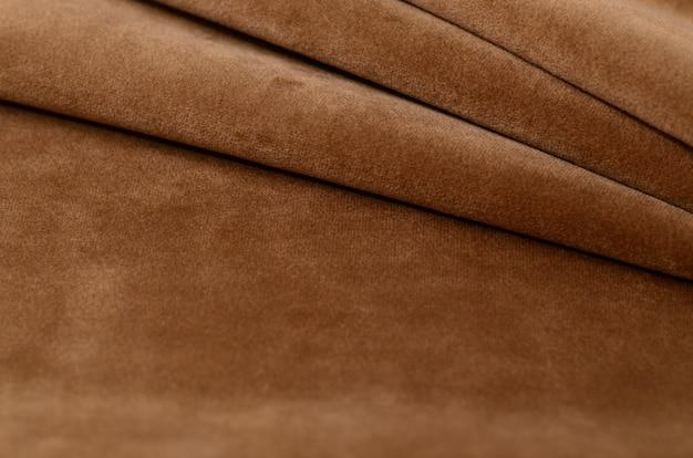 茶色のベロア繊維サンプル。ファブリックのテクスチャ背景