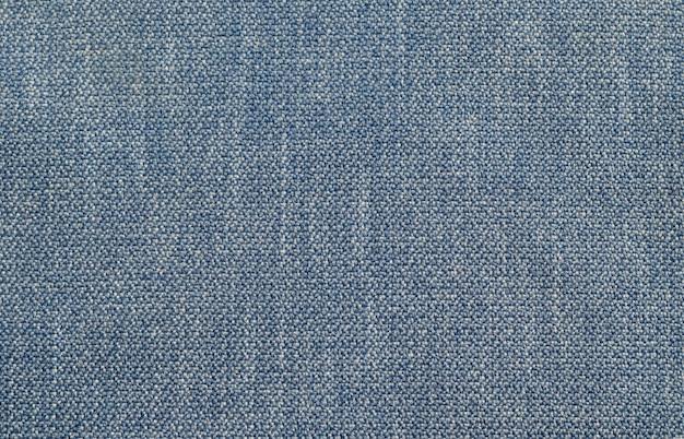 青いデニム繊維テクスチャ背景。