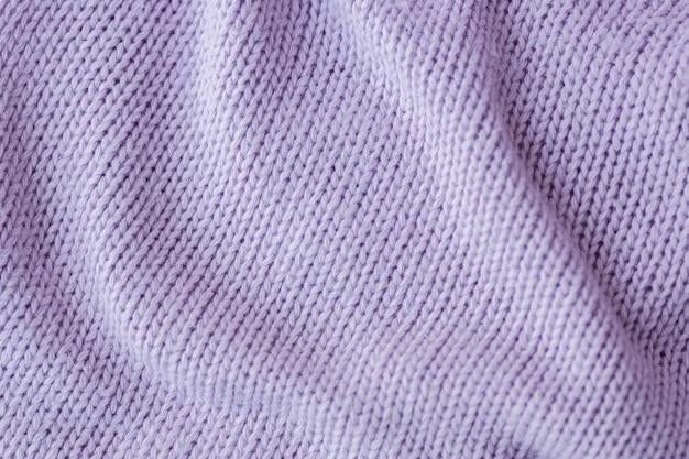 Сиреневое вязание шерстяной текстуры фона