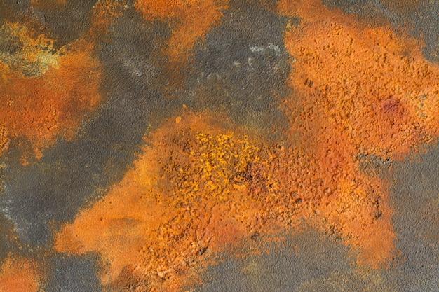 Серый бетонный фон с участками ржавчины