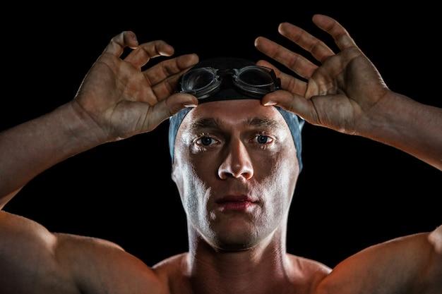 水泳ゴーグルを身に着けているスイマーの肖像画