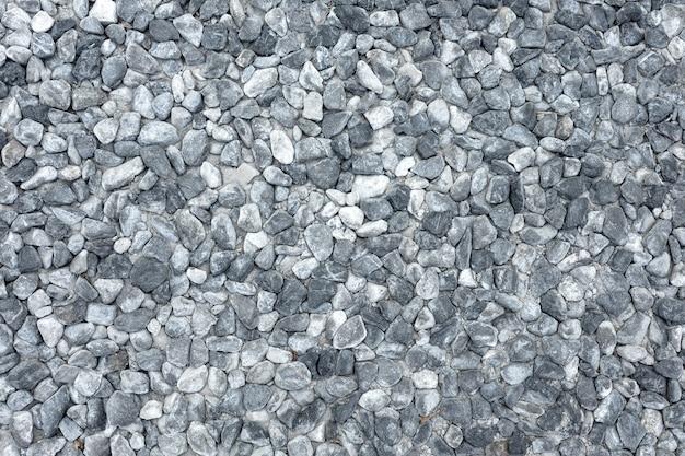砂利岩の屋外床のテクスチャ背景