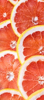 Нарезанный грейпфрут в качестве фона