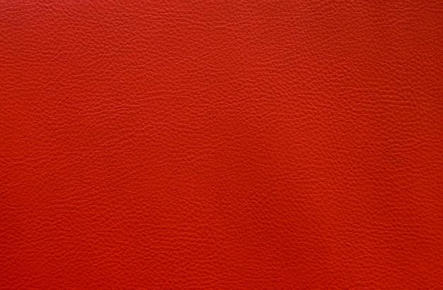 人工の赤い革をテクスチャ背景の小さなパターンを閉じる