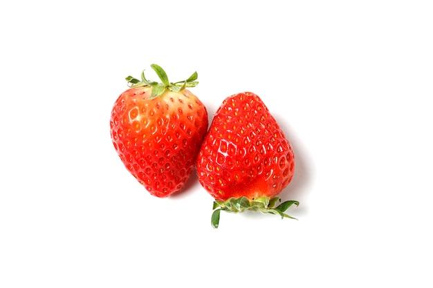 Клубника изолированная на белой поверхности, конце вверх, здоровая концепция еды, натуральные продучты.