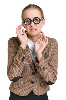 メガネを掛けて動揺女性