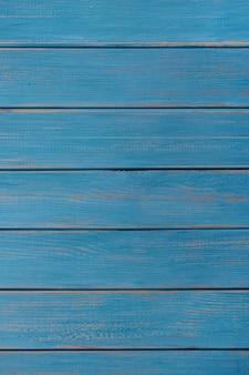 青い木製の背景夏のビーチの垂直
