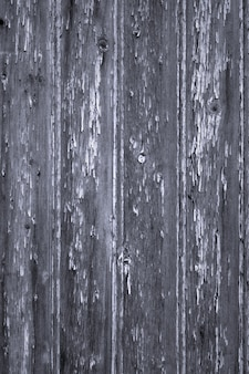 古い剥離塗料の木製パネルの背景の垂直