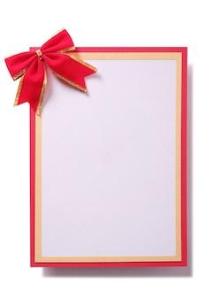 Рождественская подарочная карта красный бант золотой бордюр вертикальный