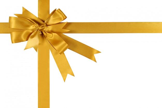 Подарочная лента из желтого золота на белом фоне