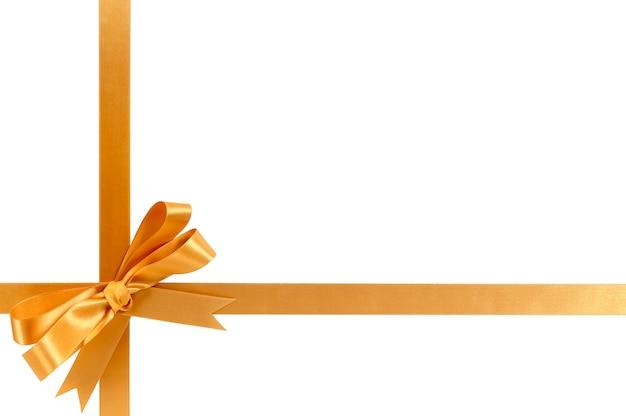 Золотая подарочная лента лук горизонтальный нижний угол крест форма, изолированные на белом.