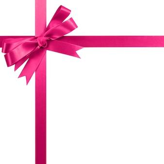 ピンクのギフトリボン弓白で隔離垂直コーナー枠。