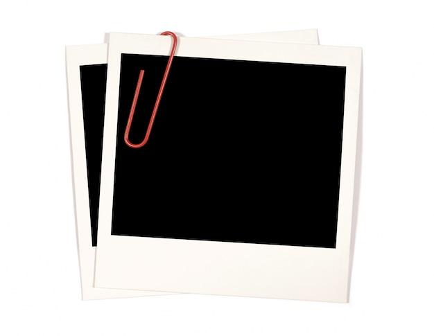 赤いペーパークリップ付きポラロイドのインスタント写真のプリント