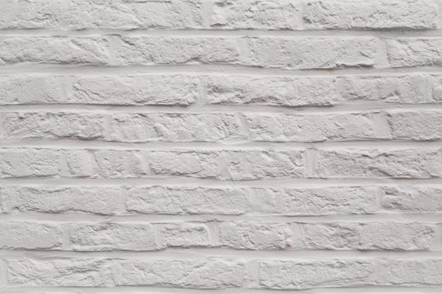 背景としてモダンな白いレンガの壁のテクスチャ