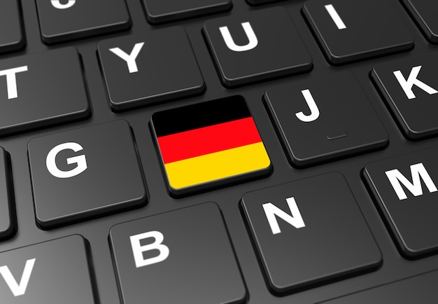 黒いキーボードにドイツの国旗を持つボタンのクローズアップ